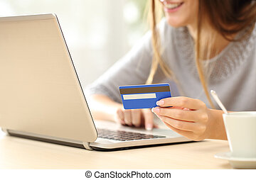 Woman buying online with credit card - Close up of a happy...