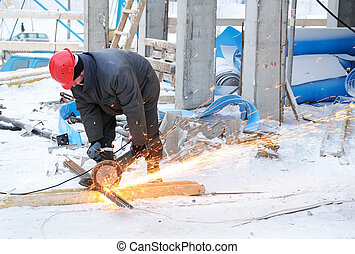 worker at building construction site - worker in workwear...