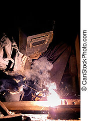 welding work - welder at work with electrode and welding arc