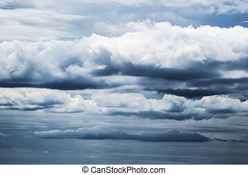 Rainy clouds - Multiple layers of ominous storm clouds