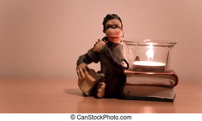 Figurine candleholder pensive monkey close-up The candle...