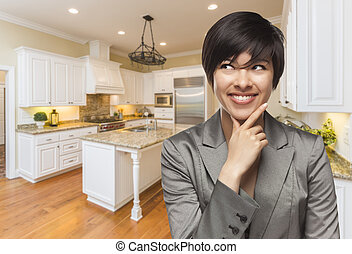 Mixed Race Woman Looking Back Over Shoulder Inside Custom Kitchen