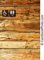 Sign of public toilets WC on wooden background