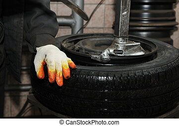 tyre repairing - taking off tyre from car wheel disc for...