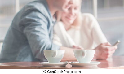 Young couple enjoying themselves at the restaurant. - Happy...