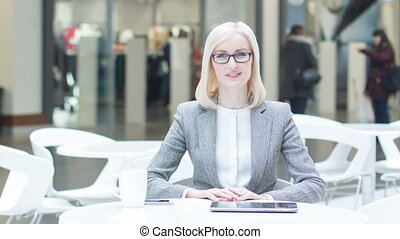 Female manager sitting at the table and talking. - Leading...
