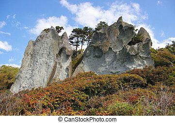 Freakish rock on cape Stolbchatyj, island Kunashir, the...