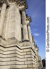 Side view of Reichstag in Berlin - Imposing columns of...