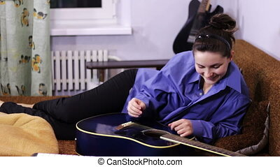Creative Happy Girl Playing Guitar - Cheerful in love couple...