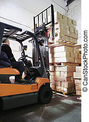 Forklift loader in warehouse - Electric forklift in...