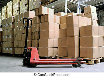 manual fork pallet truck in warehouse - Group of carton...