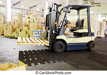 Forklift stacker in warehouse