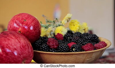 Adding Blackberry to the Bowl - Closeup shot of a bowl with...