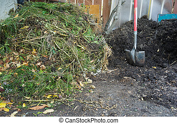 Composting - ready and fresh composting piles - Two...