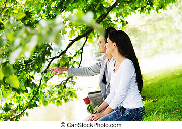 Lovely couple on a romantic date in a park - Young lovers...