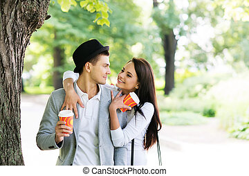 Lovely couple on a romantic date in a park - Young couple...