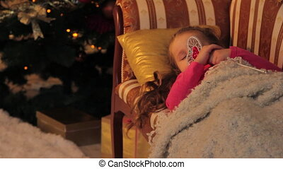 Girl Dreaming about Christmas Gifts - Little girl is resting...