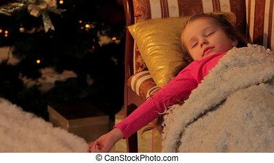 Girl Resting before Christmas - Little girl is resting on...