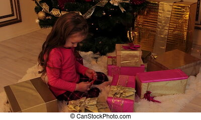 Girl Getting a Smartphone for Christmas - Little girl is...