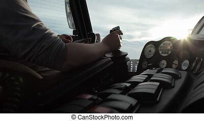 Man Driving a Snowcat - Closeup shot of male arms on...