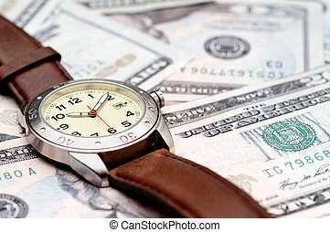 Horizontal image of a wristwatch on American currency