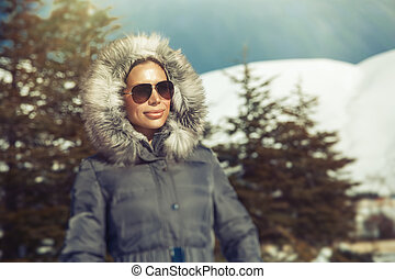 Beautiful woman in winter mountains
