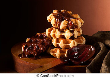 chocolate syrup and Belgian waffles - Belgian waffles in...