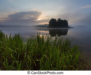 Lake sunrise in summer - Beautiful, mystic sunrise over...
