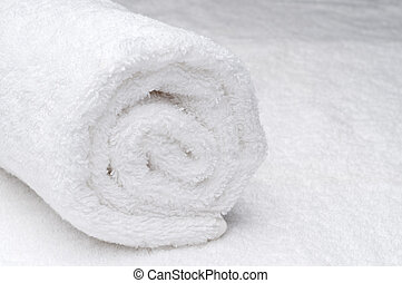 rolled up white spa towel
