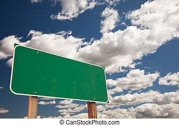 Blank Green Road Sign Over Clouds with Text Room - Blank...