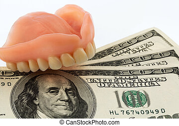 dentures and dollar bills symbol photo for dentures,...