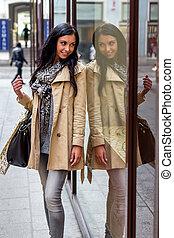 shopping woman - a young woman at einkausbummel shopping in...