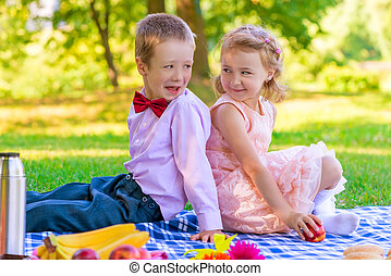 Portrait of children on a picnic in the park