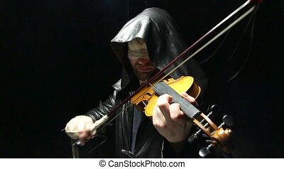 Blind man playing on a violin, video on black background
