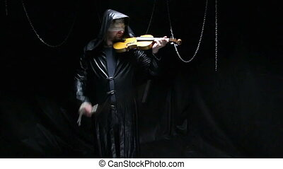 Blind musician playing on a violin, video on black...