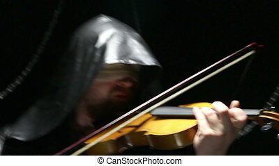 Blind fiddler playing on a violin, video on black background