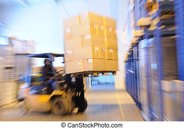 loader in a warehouse - Electric forklift in warehouse...