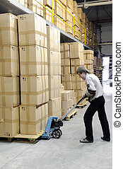 manual fork pallet truck operator in warehouse