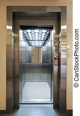 Elevator - Opened modern elevator doors in a new building.