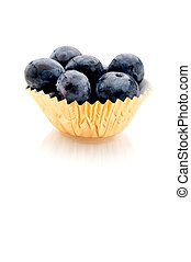 Vertical image of blueberries in a gold foil cup