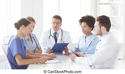 group of doctors meeting at hospital office - hospital,...