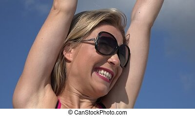 Excited Blonde Woman Wearing Sunglasses
