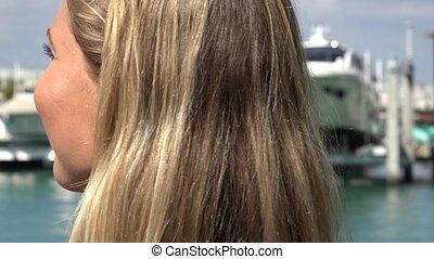Smiling Blonde Woman at Marina