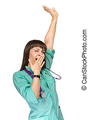 Woman doctor tired yawning Caucasian female health care...