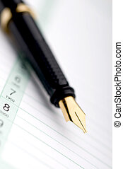 Macro of a fountain pen on a day planner - Macro of a...