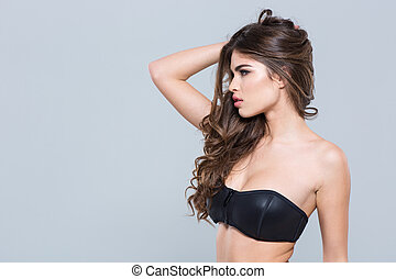 Profile of charming alluring attractive young woman in black bra