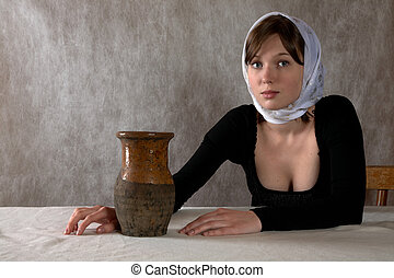 Portrait of the girl in a kerchief in an interior