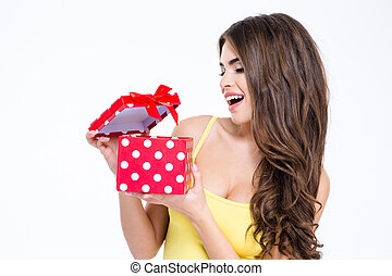 Young attractive woman opening present box