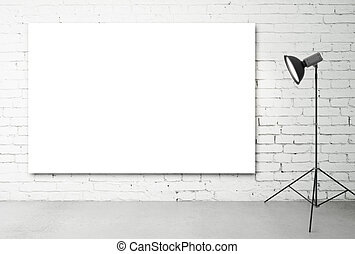 studio with a light set-up and placard