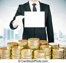 Businessman with blank white paper list in hand and stacks...